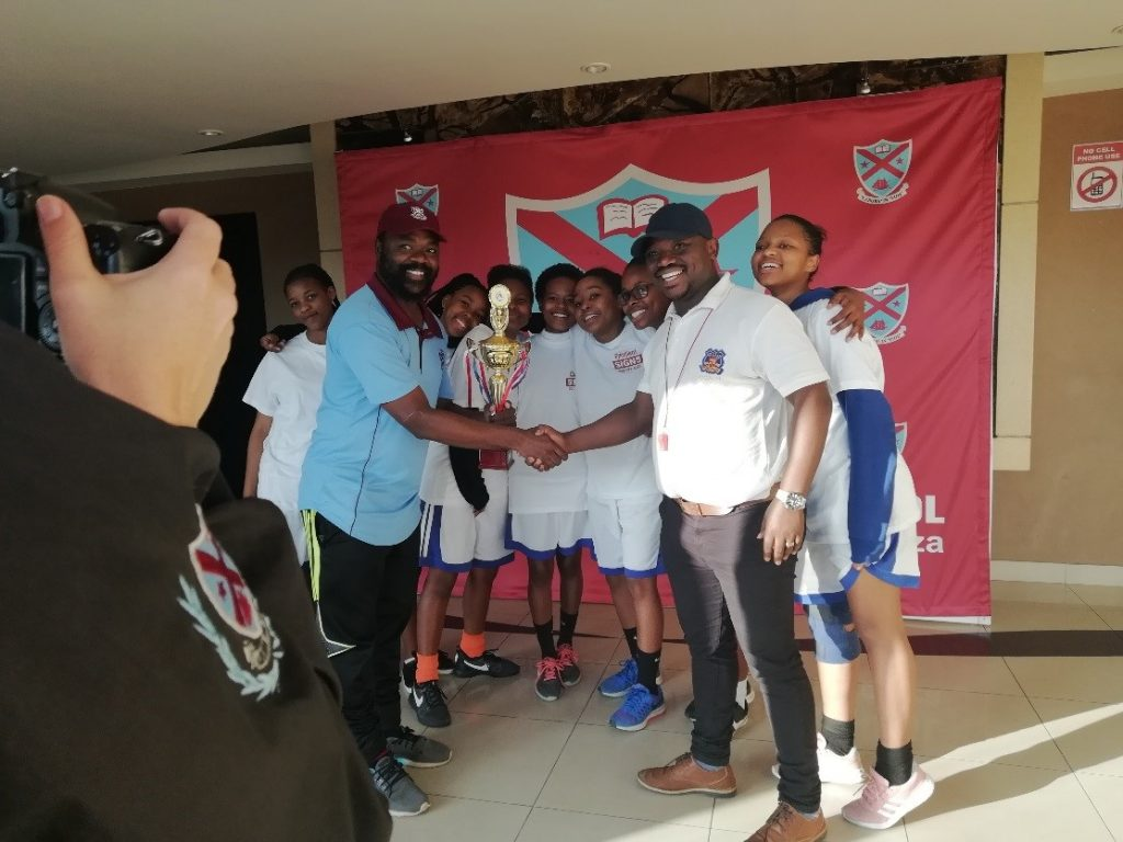 Basketball Team victorious at Women's Day Tournament.